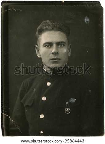 USSR - CIRCA 1938: A young man with a sports badge on his chest, circa 1938 - stock photo