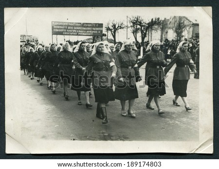 USSR - CIRCA 1954: Antique photo shows Demonstration of military women with slogans about health - stock photo