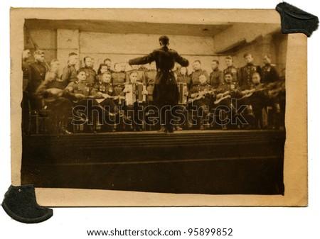 USSR - CIRCA 1949: concert of amateur orchestra Soviet Army, Birobidzhan, Jewish Autonomous Region, Far East, Russia, circa 1949 - stock photo