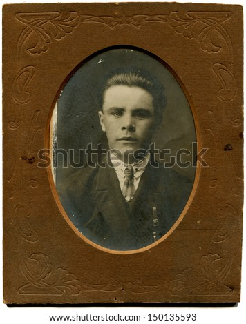 USSR - CIRCA May 15, 1932: Antique photo shows studio portrait of man in suit, May 15, 1932  - stock photo