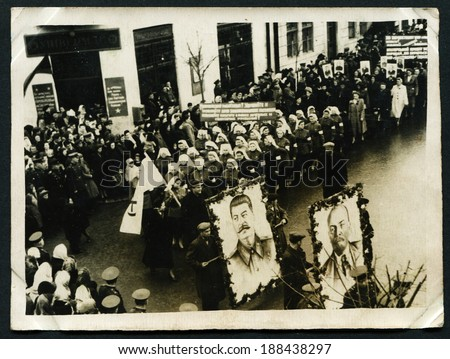USSR - CIRCA MAY 1, 1954: Vintage photo shows International Workers' Day. People have a picture of Lenin and Stalin, MAY 1, 1954 - stock photo