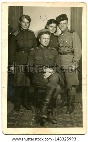USSR - CIRCA  May 19, 1944: Vintage photo shows studio photography of two soldiers and two nurses of the Red Army, May 19, 1944 - stock photo