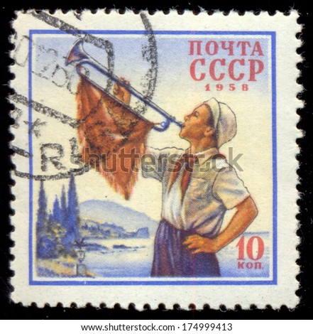 USSR - CIRCA 1958: Postage stamp printed in former Soviet Union features portrait of pioneer blowing the trumpet, circa 1958 - stock photo