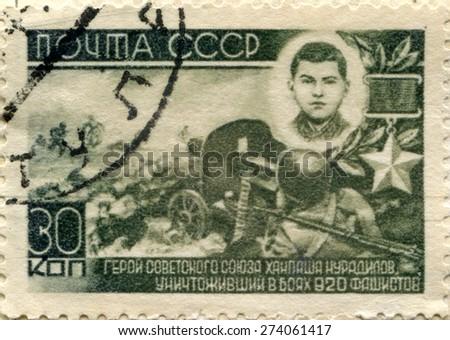 USSR - CIRCA 1945: Postage stamp printed in the USSR shows the military battle. Title: Hero of the Soviet Union Khanpasha Nuradilov. World War II. Circa 1945 - stock photo