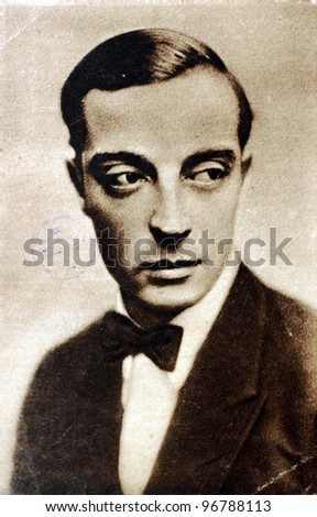 USSR - CIRCA 1930: Postcard printed in the USSR shows photo of American comic actor, filmmaker, producer and writer Buster Keaton (1895-1966), circa 1930. - stock photo