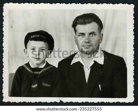 Ussr - CIRCA 1970s: An antique Black & White photo shows studio portrait of father and son - stock photo