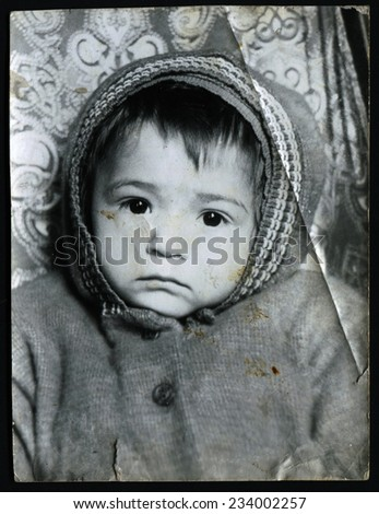 USSR - CIRCA 1970s: An antique photo show little girl in winter clothes - stock photo