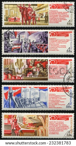 USSR - CIRCA 1971: series of postage stamps printed in USSR shows communism in the USSR. Decisions of the congresses of the CPSU.Communist slogans about industrialization and socialism, circa 1971 - stock photo