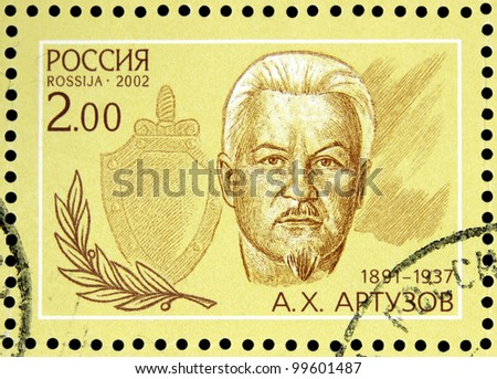 """USSR - CIRCA 2002: stamp printed in USSR shows portrait of A. K. Artuzov (1891-1937) with inscription in block """"Outstanding agents 1922 - 1937"""", series  series 80 years of Soviet secret service, circa 2002 - stock photo"""