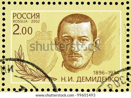 """USSR - CIRCA 2002: stamp printed in USSR shows portrait of I. Demidenko (1896-1934) with inscription in block """"Outstanding agents 1922 - 1937"""",  series 80 years of Soviet secret service, circa 2002 - stock photo"""