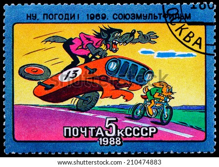 USSR - CIRCA 1988: stamp printed in USSR, shows rabbit and wolf cartoon, Just you Wait!, series Animated Soviet Cartoons, circa 1988 - stock photo