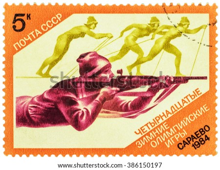 USSR - CIRCA 1984: stamp printed in USSR shows shooting man and running skiers, devoted to the Winter Olympic Games in Sarajevo, series, circa 1984 - stock photo