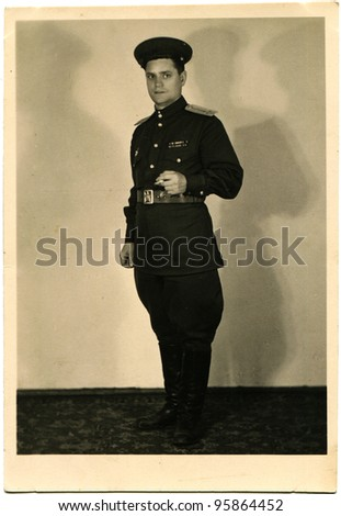 USSR - CIRCA 1950: Studio portrait of Lieutenant Soviet Army with a cigarette in his hand, circa 1950 - stock photo