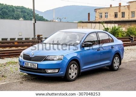 USTI NAD LABEM, CZECH REPUBLIC - JULY 21, 2014: Motor car Skoda Rapid at the city street. - stock photo