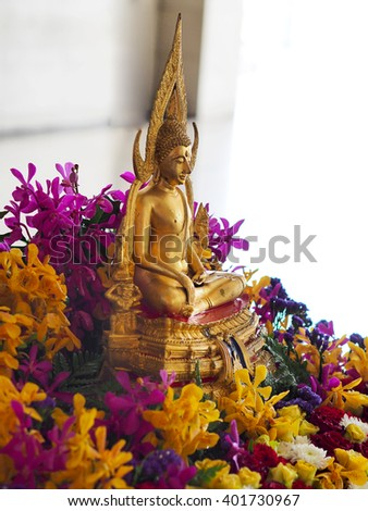 Usually, Thai people will decorate The Buddha with flowers for Songkran Festival, Water Festival - stock photo