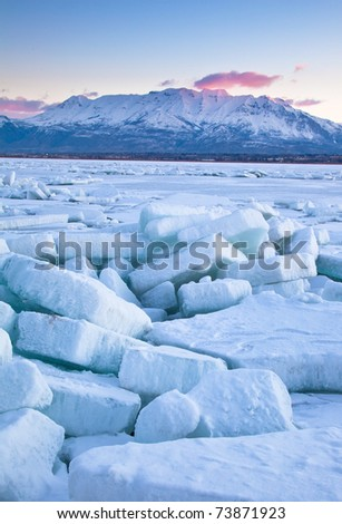 Utah Lake as the ice begins to break up with Timpanogas Mountain in the background - stock photo