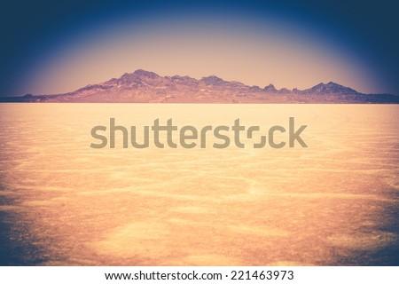 Utah Salt Flats Landscape. Colorful Vintage Grading. Cracked Lake Bed - stock photo
