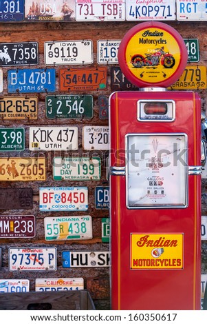 UTAH, USA - NOVEMBER 16: Various old American license plates behind antique gas pump on November 16, 2008. Gas station along the rural road in Utah - stock photo