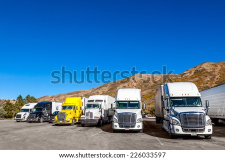 UTAH, USA - OCT 7: Trucks seen in the parking lot of the Utah highway rest area, October 7, 2013, UTAH, USA - stock photo