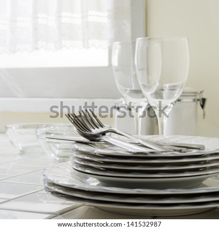 utensils on kitchen table - stock photo