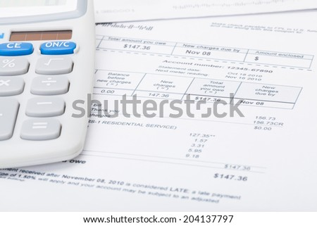 Utility bill and calculator - stock photo