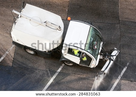 utility service company workers with street sweepers electrical vehicles cleaning the street city - stock photo