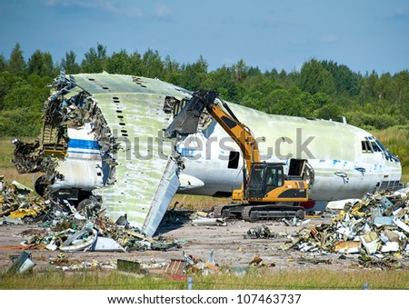 utilization of the transport plane with equipment use - stock photo