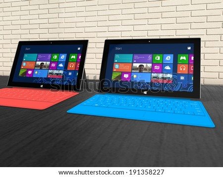 UTRECHT, THE NETHERLANDS - 05 MAY 2014 - Microsoft Surface Pro tablets on a shelf. - stock photo