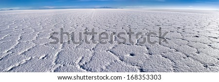 Uyuni Salt Flats, Potosí and Oruru departments, Bolivia. The world's largest salt flat at over four thousand square miles. It contains fifty to seventy percent of the world's lithium reserves.  - stock photo