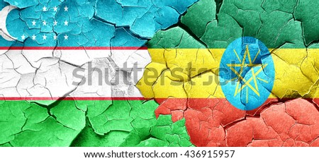 Uzbekistan flag with Ethiopia flag on a grunge cracked wall - stock photo