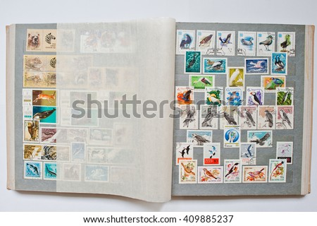 UZHGOROD, UKRAINE - CIRCA APRIL, 2016: Collection of postage letter with stamps in album printed from USSR, circa 1965-1981 - stock photo