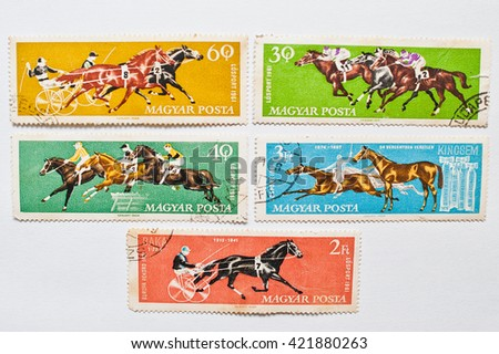 UZHGOROD, UKRAINE - CIRCA MAY, 2016: Collection of postage stamps printed in Hungary shows equestrian and horse riding sport, circa 1961 - stock photo