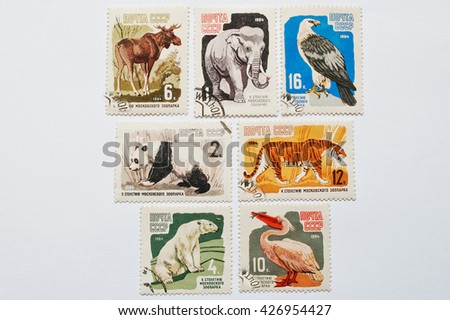 UZHGOROD, UKRAINE - CIRCA MAY, 2016: Collection of postage stamps printed in USSR shows different wild animals to the centenary of the Moscow Zoo, circa 1964 - stock photo