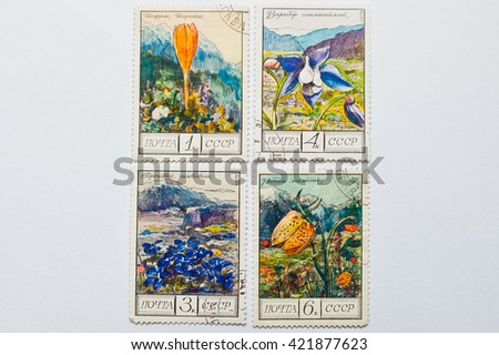 UZHGOROD, UKRAINE - CIRCA MAY, 2016: Collection of postage stamps printed in USSR, shows mountain plants and flowers series, circa 1976 - stock photo