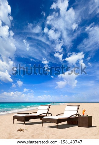 Vacation and Tourism concept. Sunbed on the beach - stock photo