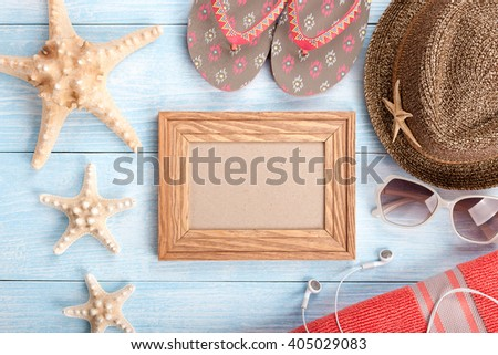 Vacation background with beach accessories and blank frame - stock photo