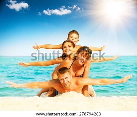 Vacation. Happy Family Having Fun at the Beach. Joyful Family. Vacation and Travel concept. Summer Holidays. Parents with Children enjoying a holiday at the sea - stock photo