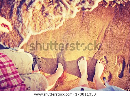 Vacation holidays background.Feet closeup of relaxing on beach in sunny summer day. - stock photo