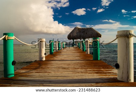 Vacation in tropic, wooden pier - stock photo
