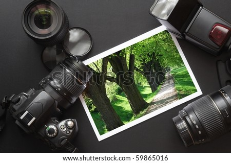 vacation or travel image concept with camera and lens - stock photo