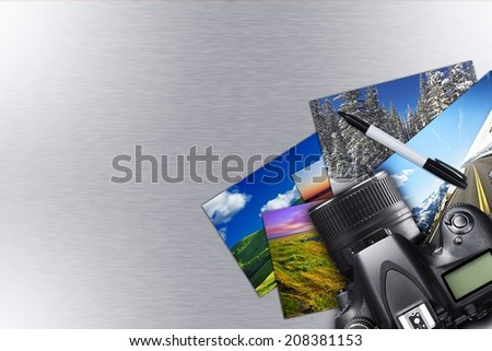 Vacation Photos and Camera on Silver Metallic Background. Copy Space Photography Concept - stock photo