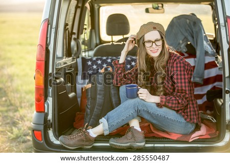 Vacation, travel - woman travel by car. backight - stock photo