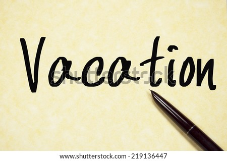 vacation word write on paper  - stock photo