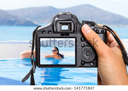 Vacations at swimming pool in Greece with the camera - stock photo
