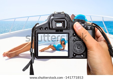 Vacations on the yacht cruise with camera - stock photo