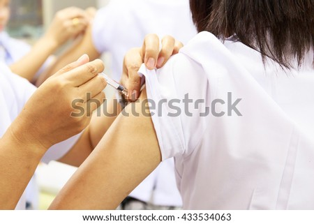 Vaccination for women in vaccine room.Doctor hand is holding needle for women vaccine. Medical concept. - stock photo