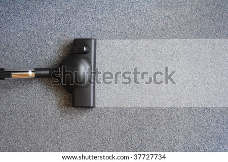 vacuum cleaner and copyspace for text message - stock photo