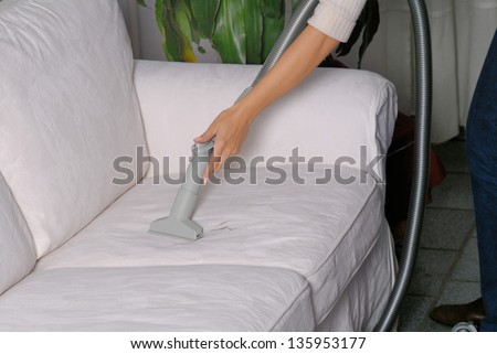 Vacuum cleaner/Woman use vacuum cleaner - stock photo