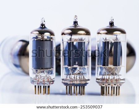 vacuum tube and incandescence bulb on white background - stock photo
