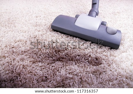 vacuuming very dirty carpet - stock photo